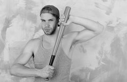 Sports and baseball training concept. Guy in grey tank top. Holds bright green bat. Player with confident face plays baseball. Man in cyan green cap on pink Royalty Free Stock Photography
