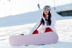 Sports beautiful girl with snowboard Stock Photos