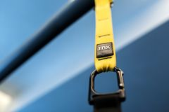 Sports belts that help to reduce weight. Black and yellow strap functional training equipment. Sport accessories. Fitness and Gym. Workout items for Healthy royalty free stock photo