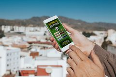 Sports betting app in a mobile phone screen. Sports betting app in a mobile phone screen royalty free stock images
