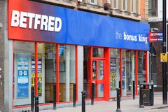 Sports betting shop. MANCHESTER, UK - APRIL 21, 2013: Exterior view of Betfred sports betting store in Manchester, UK. Betfred was founded in 1967 and has more Stock Photography
