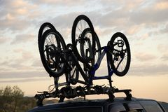 Sports bicycle over jeep stock photo