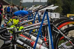 UKRAINE, LVIV - SEPTEMBER 2018: Sports bicycles in the parking area in the transfer area of the triathlon competition. Sports bicycles in the parking area in the stock photo