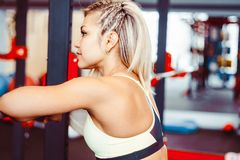 Sports girl in the gym royalty free stock image