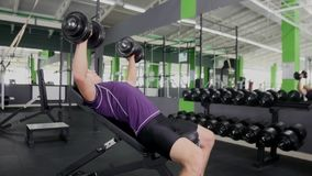 Sports bodybuilder young man hard training muscles workout in gym Royalty Free Stock Photos