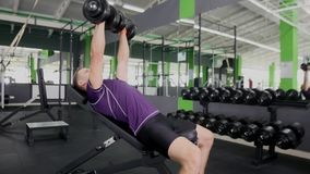 Sports bodybuilder young man hard training muscles workout in gym Stock Photo