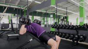 Sports bodybuilder young man hard training muscles workout in gym Stock Photography
