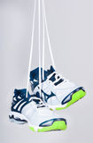 Sports boots hang on laces Stock Photos