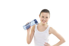 Sports bottle anyone. A beautiful asian woman holding a sports bottle in her hand. Photographed in studio Stock Photo