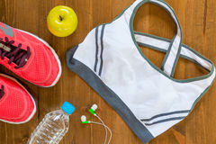 Sports bra and sneakers for fitness a top view Royalty Free Stock Image