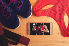 Sports bra, sneakers and weights, top view Stock Images