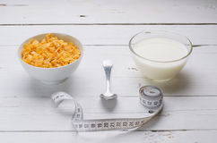 Sports breakfast, corn flakes and milk in a bowl. Royalty Free Stock Photography