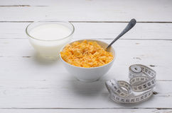 Sports breakfast, corn flakes and milk in a bowl on a wooden tab Stock Photos