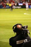 Sports camera man Royalty Free Stock Photo
