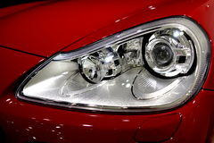 Sports car. A red sports car headlamp royalty free stock image
