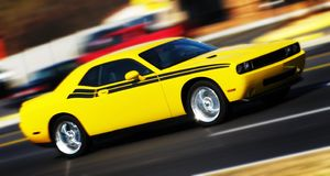 Sports car. On the road in motion Royalty Free Stock Photo