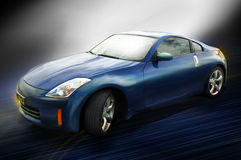 Sports car. A blue sports car on a blue streaked surface with back lighting Royalty Free Stock Image