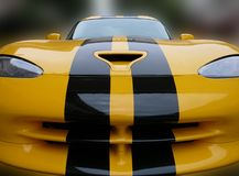 Sports Car. Front view of a yellow sportscar stock photo