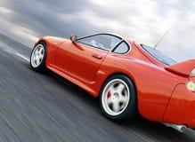 Sports Car. A Red Sports Car Speeding on Blurry Asphalt Road. 3D Render Stock Image
