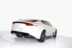 Sports car. Futuristic white sports car on a platform, isolated background Stock Photos