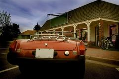 Sports car. Classic sports car parked in front of a store Stock Image