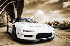 Sports Car. Picture of a white sports car against a sepia background royalty free stock photos