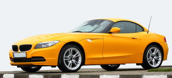 Sports car. Luxury yellow sports car (vehicle) isolated Stock Photos