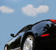 Sports car. In motion against blue sky royalty free stock photos