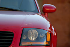 Sports car. Audi TT closeup, shallow depth of field with focus on headlight Royalty Free Stock Photography
