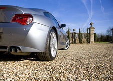 Sports Car. Sliver Sports Car on drive royalty free stock images