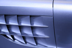 Sports car. Side grill of a sports car (No logo/trademark Royalty Free Stock Photos