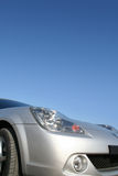 Sports car. Front view of a sports car over the blue sky Royalty Free Stock Photo