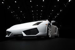 Sports car. White sports car on a black background Royalty Free Stock Images