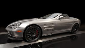 Sports car. Silver sports car on a black background Royalty Free Stock Images