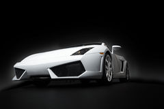 Sports car. White sports car on a black background Stock Image