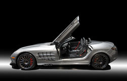 Sports car. Silver sports car on a black background Royalty Free Stock Photos