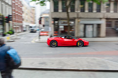 Sports car in the city. Sports car driving in  london. Great for lifestyles articles Royalty Free Stock Photography
