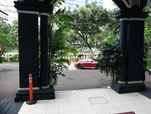 Sports car in the city parked at the entrance to the hotel. stock images
