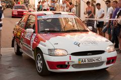 Sports car compete Prime Yalta Rally. YALTA, UKRAINE - SEPTEMBER 14, 2012: riders ROSCHENKO Volodymyr and SULYAYEV Sergiy from Ukraine on Ford Escort compete Royalty Free Stock Photography