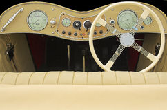 Sports car dash. Vintage sports car cockpit with cream interior stock photo