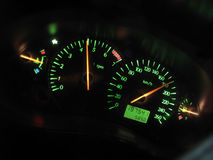 Sports car dashboard at night. Closeup of a tachometer and speedometer on a sports car dashboard Stock Images