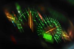 Sports car dashboard at night. Closeup of a tachometer and speedometer on a sports car dashboard Royalty Free Stock Photography
