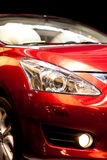 Sports car detail. Red sports car  front view Stock Photos