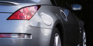 Sports car detail. Side of a sports car, highly polished bodywork reflecting the sky stock photo