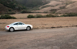 Sports Car on Dirt Road. Luxury Sports Car on Back Dirt Road stock image