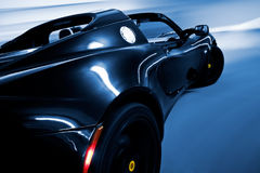 Sports Car Driving in Motion. Sports Car In Motion Driving Fast, Speed Blur royalty free stock photo