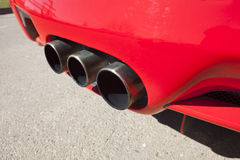 Sports car exhaust pipe Stock Photos