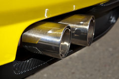 Sports car exhaust pipe Royalty Free Stock Image