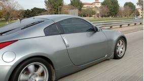 Sports car on the freeway. Speeding sports car