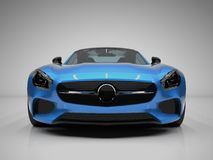 Sports car front view. The image of a sports blue Stock Photos